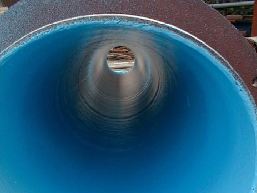 Waterline being applied to the inside of a pipe for protection