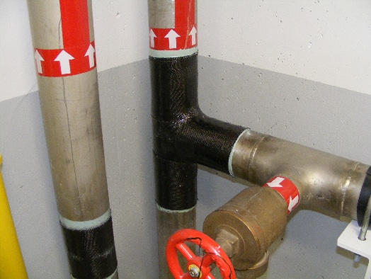 HydraWrap applied to multiple pipes for protection