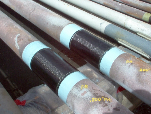 HyrdaWrap applied to multiple pipes for protection