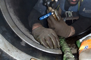 HydraTite Being installed in a small diameter Pipe by a Field Services laborer