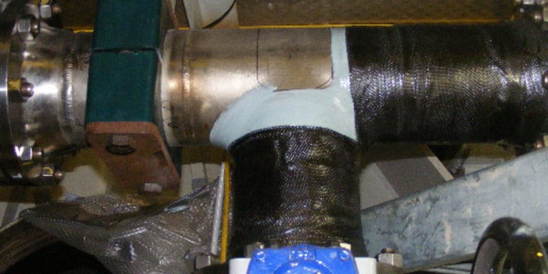 HydraWrap protecting the exterior of a tee pipe